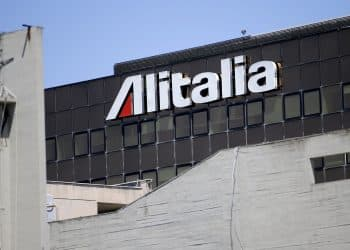 The Alitalia headquarters is seen at Fiumicino airport in Rome July 31, 2014. Italy's loss-making flag carrier Alitalia is working on a final proposal to present to Etihad on Thursday in a push to lock in an investment by the Abu Dhabi-based airline, a person close to Alitalia shareholders said on Wednesday. Etihad's plans to take a 49 percent stake in Alitalia, which has made a profit only a few times in its 68-year history, has been held up by disagreements over Alitalia's 800 million euro ($1.07 billion) debt pile, and plans for job cuts that have stoked outrage among Italian unions. REUTERS/Max Rossi (ITALY - Tags: TRANSPORT BUSINESS)