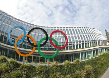 The Olympic rings are pictured in front of the International Olympic Committee (IOC) in Lausanne, Switzerland, March 17, 2020. Picture taken with a fisheye lens. REUTERS/Denis Balibouse