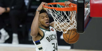 Aug 24, 2020; Lake Buena Vista, Florida, USA; Milwaukee Bucks' Giannis Antetokounmpo (34) dunks the ball against the Orlando Magic during the second half in game four of the first round of the 2020 NBA Playoffs at The Field House. Mandatory Credit: Ashley Landis/Pool Photo-USA TODAY Sports   Monday, Aug. 24, 2020, in Lake Buena Vista, Fla. (AP Photo/Ashley Landis, Pool)