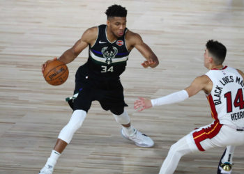 Sep 2, 2020; Lake Buena Vista, Florida, USA; Milwaukee Bucks forward Giannis Antetokounmpo (34) dribbles the ball against Miami Heat guard Tyler Herro (14) during the second half of game two of the second round of the 2020 Stanley Cup Playoffs at The Field House. Mandatory Credit: Kim Klement-USA TODAY Sports