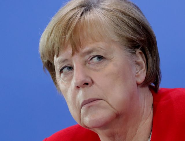 German Chancellor Angela Merkel attends a news conference after an online meeting with German state governors on the loosening of the restrictions to reduce the spread of the coronavirus disease (COVID-19), in Berlin, Germany May 6, 2020. Michael Sohn/Pool via REUTERS