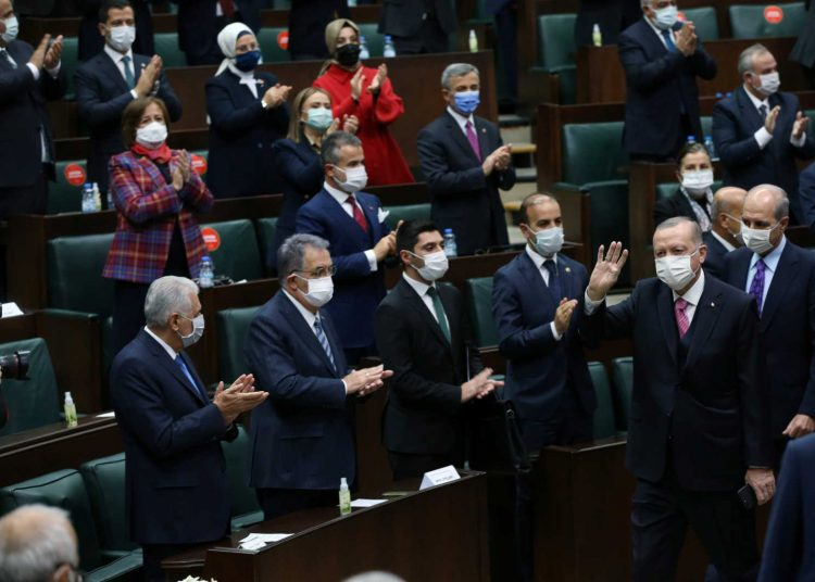 Turkish President Tayyip Erdogan greets members of his ruling AKP during a meeting at the parliament in Ankara, Turkey, November 25, 2020. Presidential Press Office/Handout via REUTERS ATTENTION EDITORS - THIS PICTURE WAS PROVIDED BY A THIRD PARTY. NO RESALES. NO ARCHIVE.