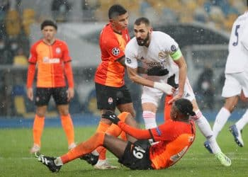 Soccer Football - Champions League - Group B - Shakhtar Donetsk v Real Madrid - NSC Olimpiyskiy, Kyiv, Ukraine - December 1, 2020 Shakhtar Donetsk's Vitao in action with Real Madrid's Karim Benzema REUTERS/Gleb Garanich