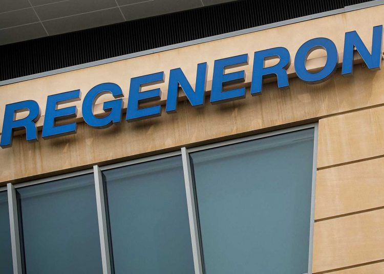 FILE PHOTO: The Regeneron Pharmaceuticals company logo is seen on a building at the company's Westchester campus in Tarrytown, New York, U.S. September 17, 2020. REUTERS/Brendan McDermid/File Photo
