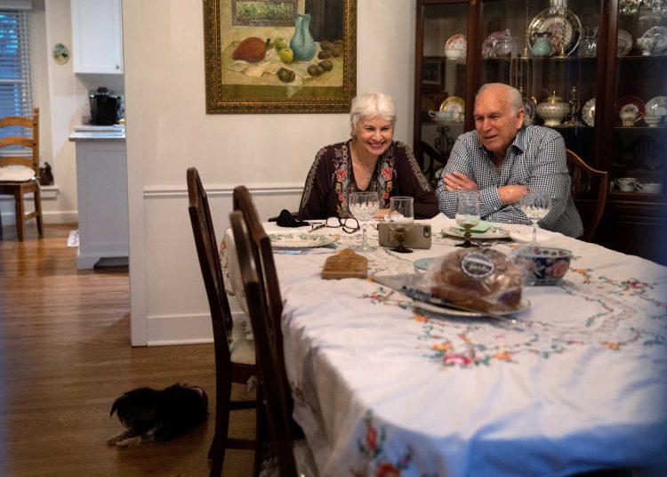 Janis and Uri Segal smile as they celebrate Thanksgiving with a virtual zoom with their family before a small dinner together as they try to prevent the spread of the coronavirus disease (COVID-19) in Detroit, Michigan, U.S. November 26, 2020.  REUTERS/Emily Elconin
