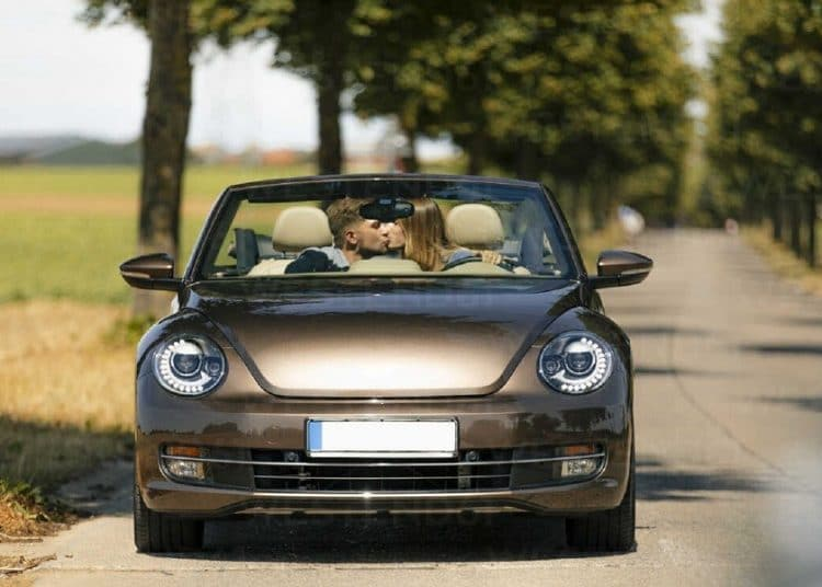 210127120624 couple kissing in convertible car on a country road GUSF01410