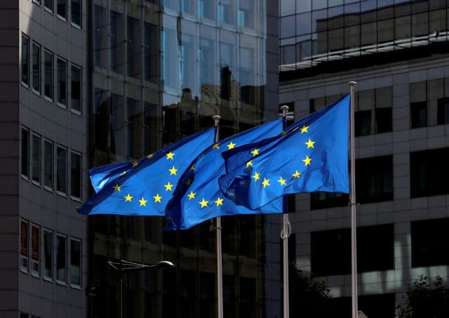 FILE PHOTO: European Union flags flutter outside the European Commission headquarters in Brussels, Belgium August 21, 2020. REUTERS/Yves Herman//File Photo