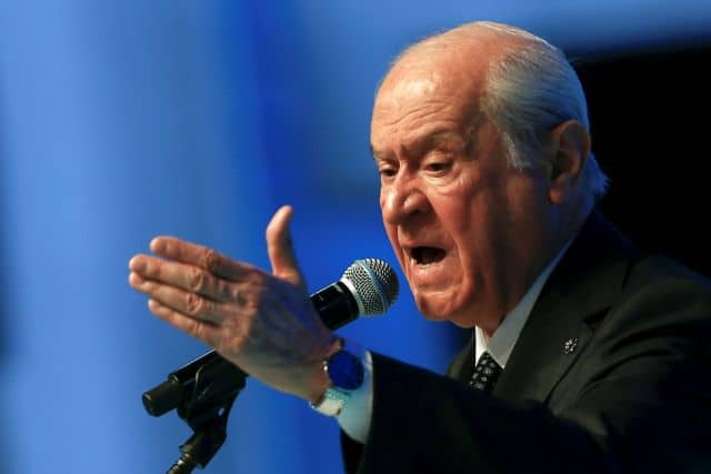 Devlet Bahceli, leader of the Nationalist Movement Party (MHP), makes a speech during his party's 13th Ordinary Grand Congress in Ankara, Turkey March 18, 2021. REUTERS/Cagla Gurdogan