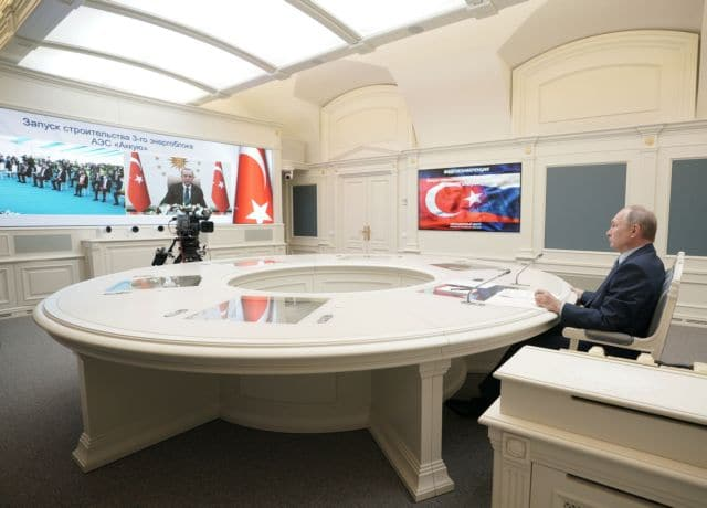 Russian President Vladimir Putin looks at a screen showing Turkish President Tayyip Erdogan as he attends a foundation-laying ceremony for the third reactor of the Akkuyu nuclear plant in Turkey, via a video link in Moscow, Russia March 10, 2021. Sputnik/Alexei Druzhinin/Kremlin via REUTERS  ATTENTION EDITORS - THIS IMAGE WAS PROVIDED BY A THIRD PARTY.