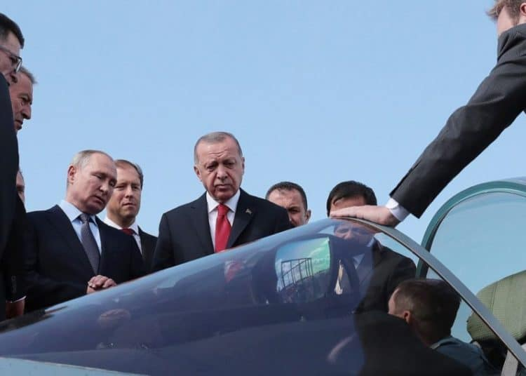 """A handout picture taken and released on August 27, 2019, by the Turkish Presidential Press service, shows Russian President Vladimir Putin (C-L) and his Turkish counterpart Recep Tayyip Erdogan (C-R) inspecting a Sukhoi Su-57 fifth-generation jet fighter aircraft during the MAKS 2019 International Aviation and Space Salon opening ceremony in Zhukovsky, outside Moscow. - Russian President Vladimir Putin and Turkish leader Recep Tayyip Erdogan met for talks in Moscow on August 27 as they seek common ground on the deadly fighting in northwestern Syria. The meeting came ahead of a September 16 summit in Ankara that will bring together the main foreign players in Syria's conflict -- Putin, Erdogan and Iran's President Hassan Rouhani. (Photo by Handout / TURKISH PRESIDENCY PRESS OFFICE / AFP) / RESTRICTED TO EDITORIAL USE - MANDATORY CREDIT """"AFP PHOTO / TURKISH PRESIDENTIAL PRESS OFFICE"""" - NO MARKETING - NO ADVERTISING CAMPAIGNS - DISTRIBUTED AS A SERVICE TO CLIENTSHANDOUT/AFP/Getty Images"""
