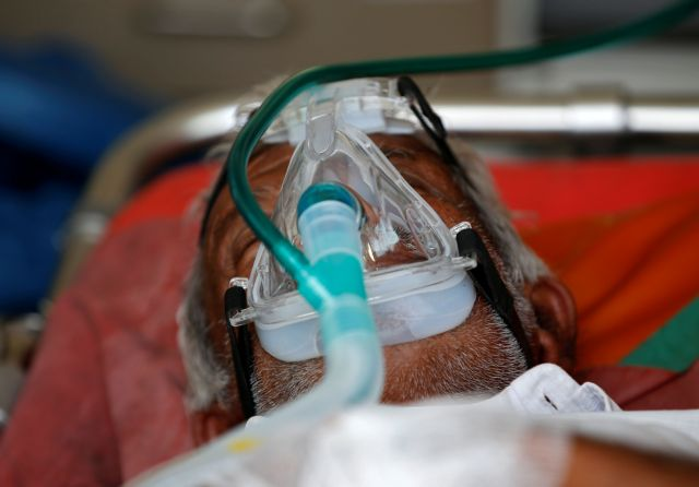 A patient wearing an oxygen mask is seen inside an ambulance waiting to enter a COVID-19 hospital for treatment, amidst the spread of the coronavirus disease (COVID-19) in Ahmedabad, India, April 25, 2021. REUTERS/Amit Dave