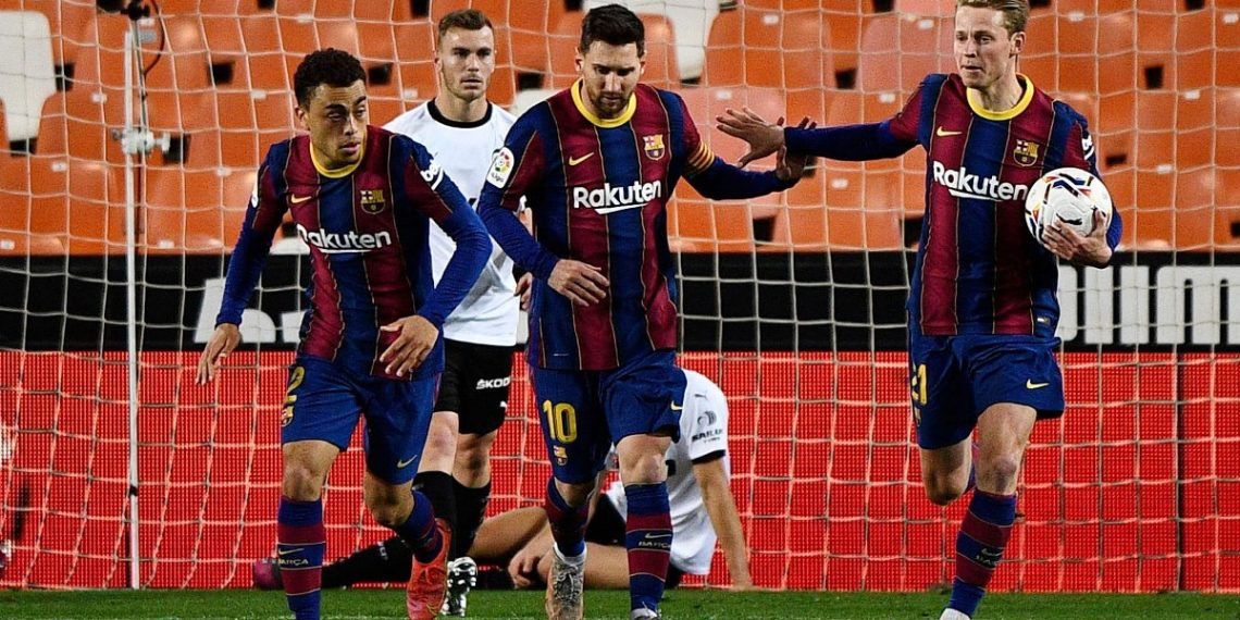 Soccer Football - La Liga Santander - Valencia v FC Barcelona - Mestalla, Valencia, Spain - May 2, 2021 Barcelona's Lionel Messi celebrates scoring their first goal with teammates REUTERS/Pablo Morano