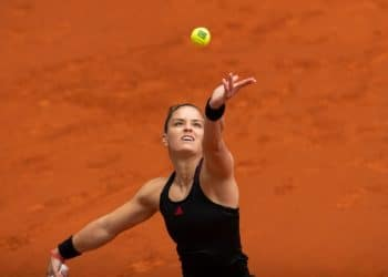 epa09169329 Greek tennis player Maria Sakkari in action against Amanda Anisimova of USA during their Mutua Madrid Open tennis match at Caja Magica court in Madrid, Spain, 30 April 2021.  EPA/RODRIGO JIMENEZ