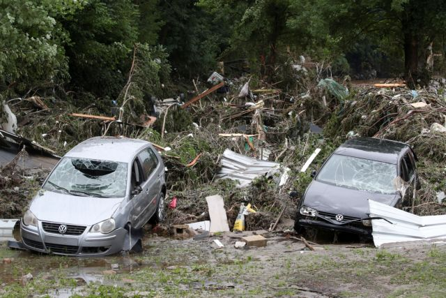 Vehicles damaged by heavy rainfalls are pictured in Pepinster, Belgium, July 16, 2021. REUTERS/Yves Herman