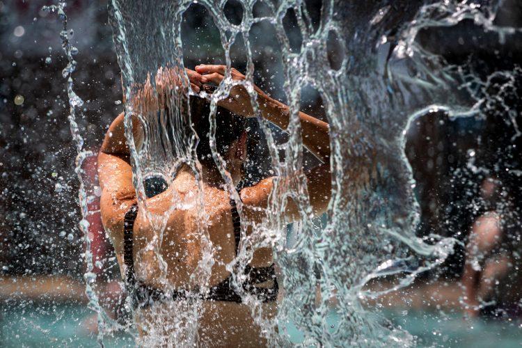 A woman cools off in a public pool during an unprecedented heat wave in Portland, Oregon, U.S. June 27, 2021. REUTERS/Maranie Staab
